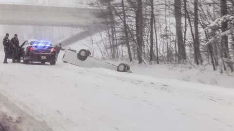 Maine State Police assist a motorist whose car spun out and ended up on it's roof near the Northbound Exit 47 on the Maine Turnpike.  No word of injuries or damage. (iWitness/Michael Leonard)