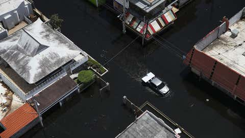 A flooded street is seen as people deal with the aftermath of Hurricane Maria on September 25, 2017 in San Juan Puerto Rico. Maria left widespread damage across Puerto Rico, with virtually the whole island without power or cell service. (Joe Raedle/Getty Images)