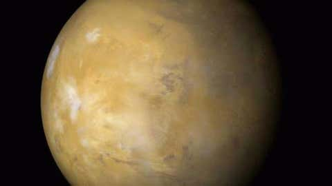 This image released Aug. 27, 2003 captured by NASA's Hubble Space Telescope shows a close-up of Mars when the telescope was 34,648,840 miles away. The picture, assembled from a series of exposures, was taken just 11 hours before the planet made its closest approach to Earth in 60,000 years.