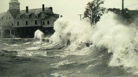 Waves crash onto shore at Woods Hole, Massachusetts during a hurricane in 1938.
