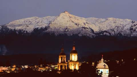 The Ajusco volcano, in the outskirts of Mexico City, appears with snow on its top after an unusual rain over Mexico City's valley, on February 21, 2009. (Photo credit: OMAR TORRES/AFP/Getty Images)