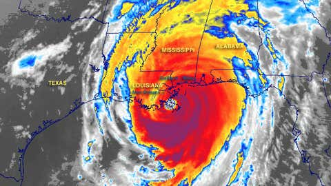 A colorized infrared satellite image showing Katrina approaching the Mississippi coast.