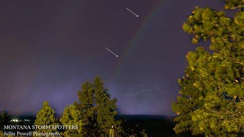 A moonbow is visible, annotated with light gray arrows, during a late-night thunderstorm in Shepherd, Montana, on July 9, 2016. (Jullie Powell Photography)