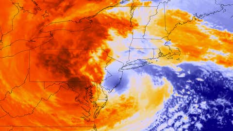 A GOES-13 satellite colorized infrared image of Sandy making landfall in New Jersey.