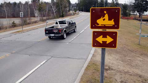 A snowmobile crossing sign is seen along Route 30 on Tuesday, Dec. 8, 2015, in Speculator, N.Y. (AP/Mike Groll)