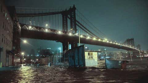 Streets are flooded under the Manhattan Bridge in the Dumbo section of Brooklyn, N.Y., Monday, Oct. 29, 2012.