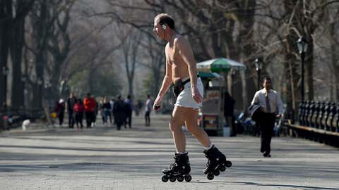 A man rollerblades near the Bethesda Terrace in Central Park, Manhattan, New York City, March 9,2016 as people take advantage of the warm weather in the city. (TIMOTHY A. CLARY/AFP/Getty Images)
