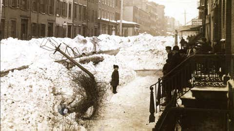 Downed wires and lamp post in Greenwich Village after the Blizzard of 1888 in New York City. (Credit: New York Historical Society Museum & Library)