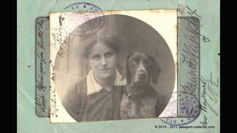 A passport from the Duchy Saxe Coburg-Gotha within the German Empire features a girl and a special companion - her dog! (Passport-Collector.com)
