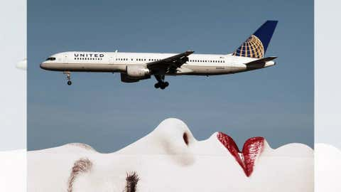 A United Airlines 757 passes a billboard on approach to Los Angeles International Airport (LAX) on January 17, 2013 in Los Angeles, California. (David McNew/Getty Images)