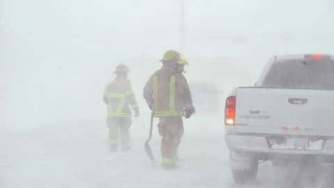 Amarillo emergency personnel assist a stranded motorist on the I-40 service road Monday, Feb. 25, 2013. (AP Photo/The Amarillo Globe News, Michael Schumacher)