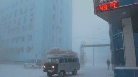 An ice fog hangs over Yakutsk, Russia with a surface temperature of -54 degrees Fahrenheit (-48 degrees Celsius).  (Photo credit:  Bolot Bochkarev)