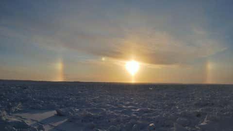 A sundog is seen over the frozen landscape outside of Yakutsk, Russia.  (Photo credit:  Bolot Bochkarev)