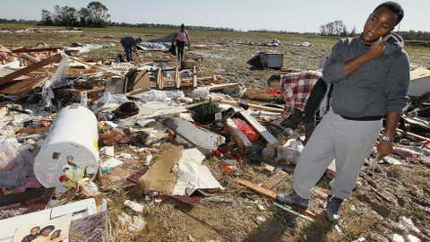 Coleman Jenkins, son of Gladys Berry, takes a break from searching for her personal possessions in the remains of her mobile home in Anguilla, Miss., Thursday, Oct. 18, 2012 following a night and early morning of severe weather that destroyed several homes in this Delta community and sent some of its residents to area hospitals. (AP Photo/Rogelio V. Solis)