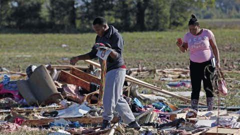 Coleman Jenkins, Gladys Berry's son, left, and cousin Carlisa Cooper rummage through the remains of Berry's mobile home in Anguilla, Miss., Thursday, Oct. 18, 2012 following a night and early morning of severe weather that destroyed several homes in this Delta community and sent some of its residents to area hospitals. (AP Photo/Rogelio V. Solis)