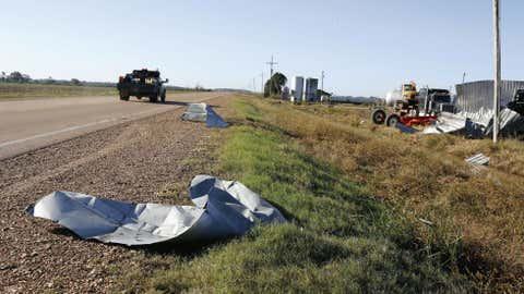 Tin roofing lie along side Mississippi Highway 149 near Louise, Miss.,Thursday, Oct. 18, 2012, following a night and early morning of severe weather that destroyed several homes in the Delta and sent some of its residents to area hospitals. (AP Photo/Rogelio V. Solis)