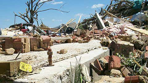 A protruding anchor bolt from slab with base plate ripped away is shown among the rubble of a destroyed home in Smithville, Mississippi, following an EF5 tornado on April 27, 2011. (NWS-Memphis)