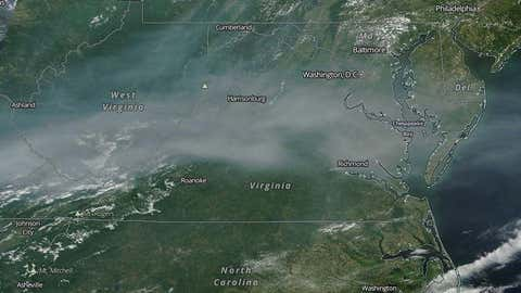 High-resolution satellite image from the NASA Terra satellite of smoke from Canadian wildfires over the Appalachians and Mid-Atlantic states on June 10, 2015.