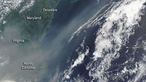 Canadian wildfire smoke pushed off the Eastern Seaboard in this high-resolution image from the Aqua satellite on July 1, 2015. The smoke is shown as a milky gray-tan texture in the image from Virginia and North Carolina northeast off the coast. (Jeff Schmaltz, MODIS Rapid Response Team/NASA)