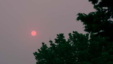 Early morning pink sun shrouded in haze from Canadian wildfires in Fond du Lac, Wisconsin, on June 9, 2015.