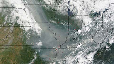 High-resolution image from NASA's Terra satellite on June 30, 2015 showing smoke plume (milky, grayish-tan) from Canadian wildfires over the Mid-Mississippi Valley, Ohio Valley, and Tennessee Valley. (Jeff Schmaltz, MODIS Rapid Response Team/NASA)