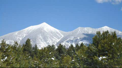 Heber Ranger Station in eastern Arizona near the Mogollon Rim measured 38 inches of snow on December 14, 1967. Image: San Francisco Peaks covered by snow near Flagstaff. From iWitness Weather contributor Andy Keller.
