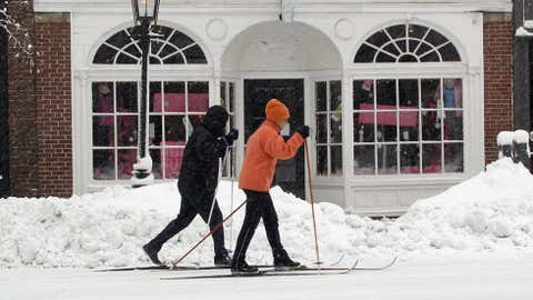 Off I-90 just to the west of Boston, the town of Natick recorded 29 inches of snow on April 1, 1997. The city of Boston was paralyzed for two days in the storm. Image: Skiers head down Charles Street in Boston on January 12, 2011 in Boston. Photo by Elsa/Getty Images