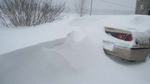 22 inches of snow fell along the Ohio River in Cannelton on December 23, 2004. Image: Snow drift buries a car in the northern part of the state in Valparaiso. From iWitness Weather contributor markjet88.