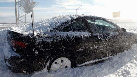 Elizabeth, located just to the south of Newark, recorded 33 inches of snow on February 14, 1899. Image: An abandoned car sits on a ramp following a major blizzard that hit the area at Newark Liberty International Airport on December 27, 2010. Photo by Jeff Zelevansky/Getty Images.