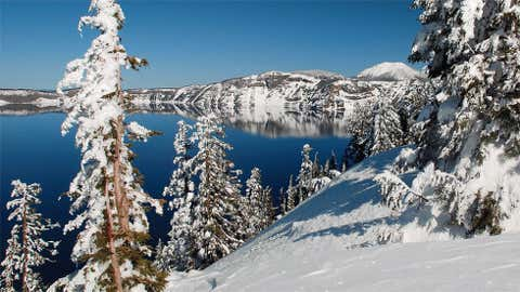 Chemult holds the daily snowfall record in Oregon with 37 inches on February 6, 1949. Image: Wintry view of Crater Lake in southern Oregon from iWitness Weather contributor oznlisa.