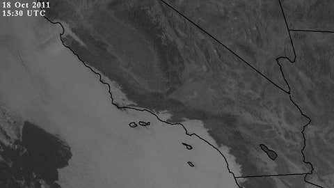 "Visible satellite image of the southern half of California on Oct. 18, 2011 at 8:30 a.m. PDT. The cloudy ""marine layer"" is shown hugging the California coast in white. (NASA/MSFC)"