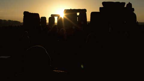 The sun passes through the stones after rising at the ancient stone circle of Stonehenge, in southern England, as access to the site is given to druids, New Age followers and members of the public on the annual Winter Solstice, Friday, Dec. 21, 2012.
