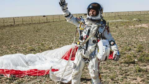 In this photo provided by Red Bull Stratos, Pilot Felix Baumgartner of Austria celebrates after successfully completing the final manned flight for Red Bull Stratos in Roswell, N.M. on Oct. 14. (AP Photo/Red Bull Stratos, Balazs Gardi)