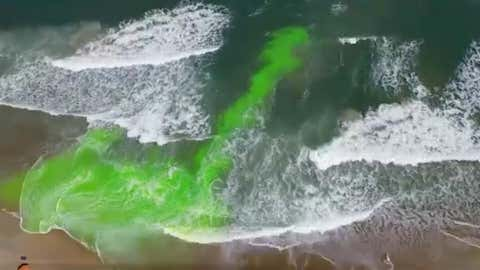 Enhanced photo (green) indicating a significant rip current.