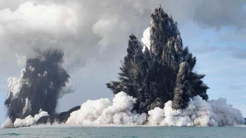 An undersea volcano is seen erupting off the coast of Tonga, sending plumes of steam, ash and smoke hundreds of feet into the air on March 18, 2009. (Dana Stephenson/Getty Images)