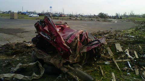 The remains of a Ford Explorer in Smithville, Mississippi. The April 27, 2011 tornado hurled the SUV about one-half mile, into the town's water tower (in the picture background) and continued on another one-quarter mile until impact. (Mississippi Emergency Management Agency/NWS-Memphis, Tennessee)