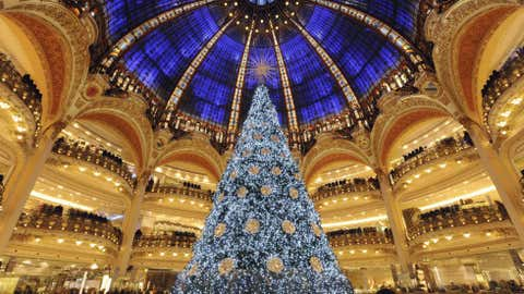 The Galeries Lafayette Paris department store has a big Christmas tree on the central ground floor. (Bertrand Guay/AFP/Getty Images)