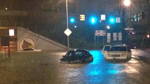 Several vehicles were submerged at the University of Louisville campus at Eastern and Third Streets. (Tim Elliot/WLKY)