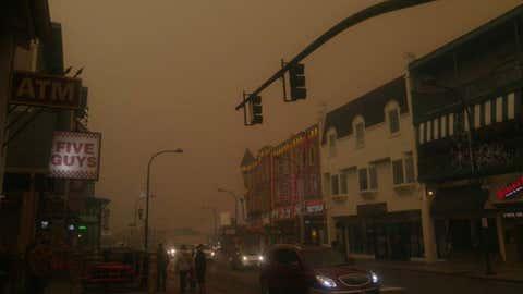 Downtown Gatlinburg, Tennessee, under a blanket of smoke.