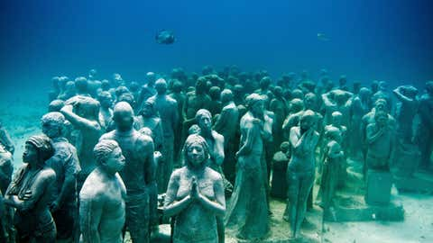 The Cancun Underwater Museum features a series of over 500 life-sized, underwater sculptures by artist Jason deCaires Taylor, and is located within Isla Mujeres National Marine Park, of the Yucatan Peninsula, Mexico. (Jason de Caires Taylor/Barcroft Media/Getty Images)
