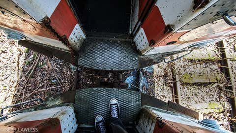 During one of his many urban exploration adventures, photographer Seph Lawless came across a train graveyard, housing many rusty, abandoned trains. (Seph Lawless)