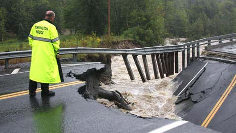 Bennington Police Chief Paul Doucette looks at a collapsed bridge on Route 9 in Woodford, Vermont, on Aug. 28, 2011.