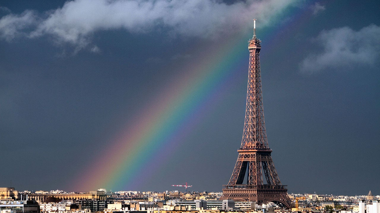 picture perfect in paris  rainbow arches over eiffel tower