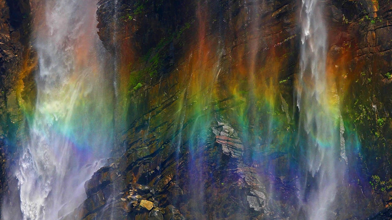 photographer captures stunning images of a  u0026 39 rainbow waterfall u0026 39  in india  photos