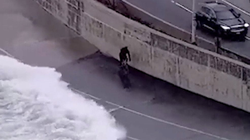Bicyclist Nearly Swallowed by Lakeshore Waves in Chicago