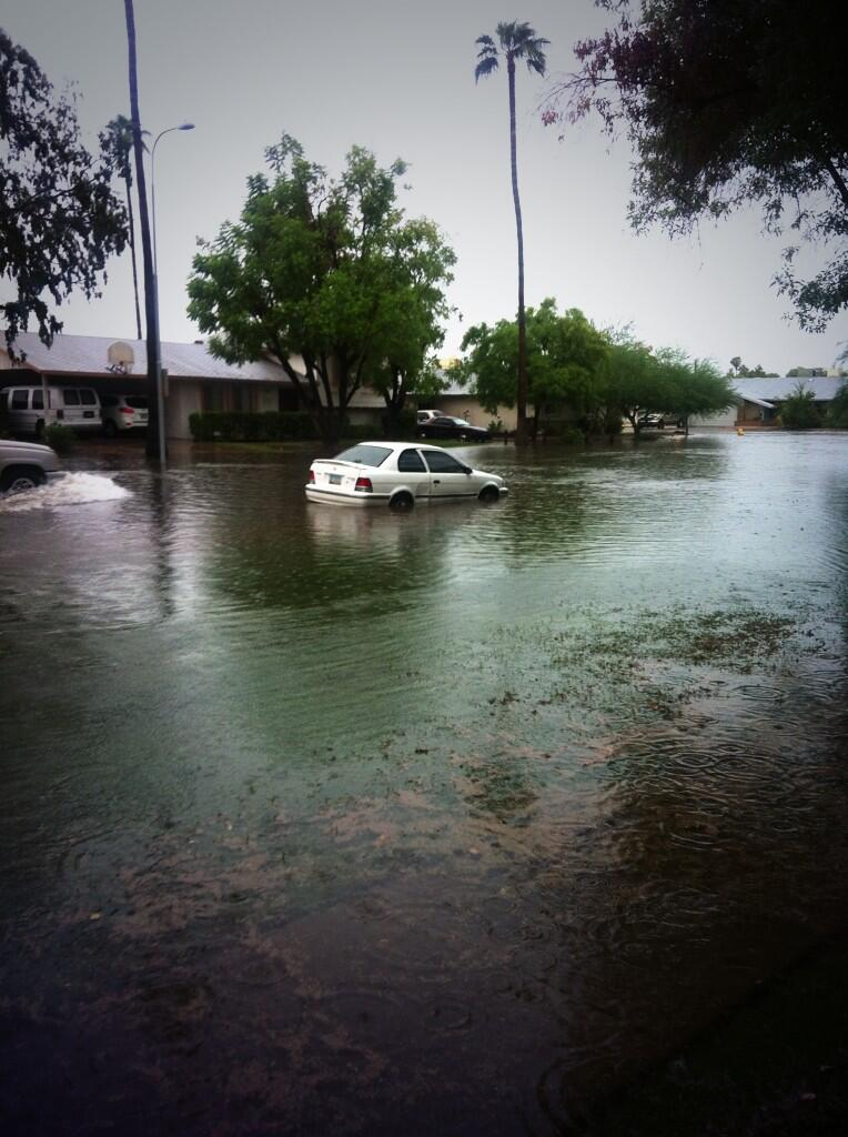 phoenix flooding  freeway flooded  some power outages