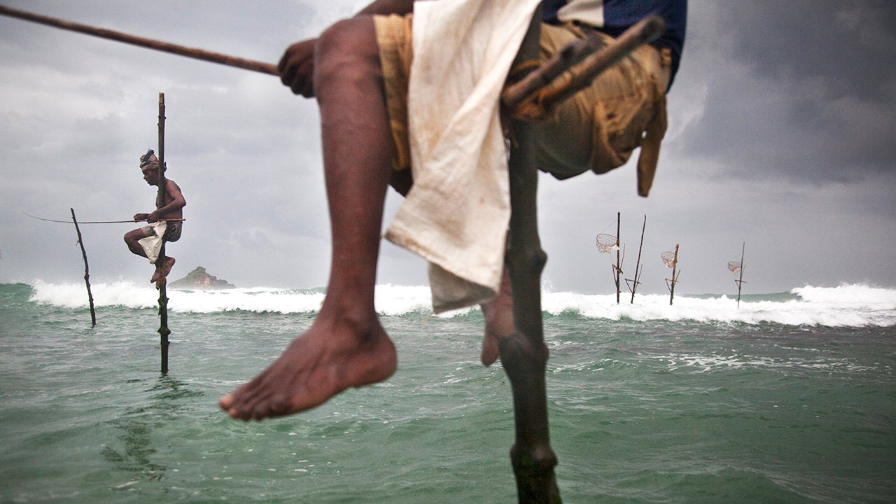Photographer Florian Müller Captures the Dying Tradition of Stilt Fishing