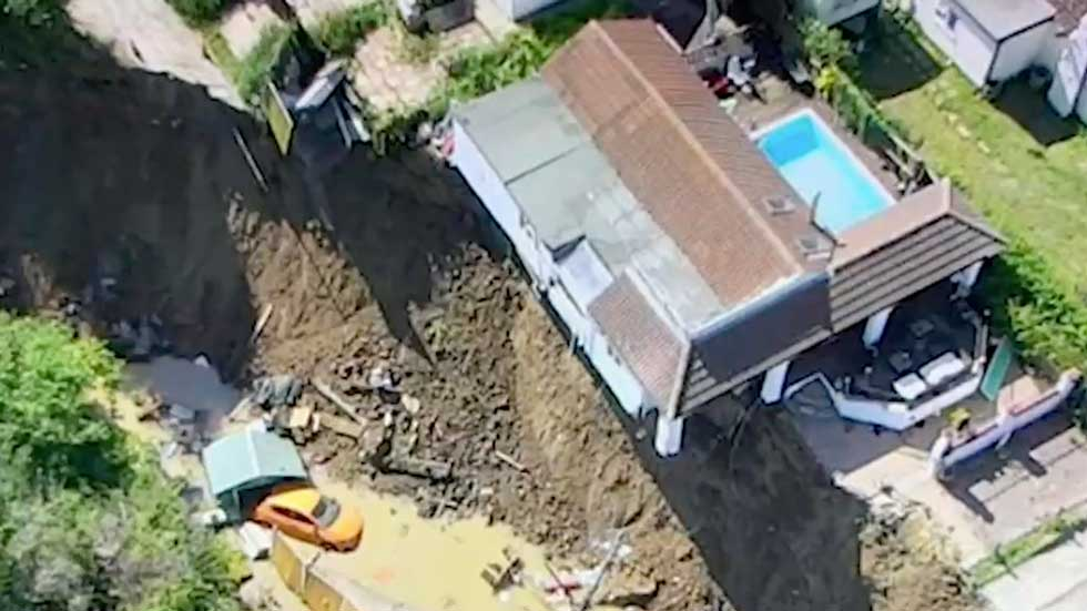 England Cliff Collapse Leaves Houses Dangling