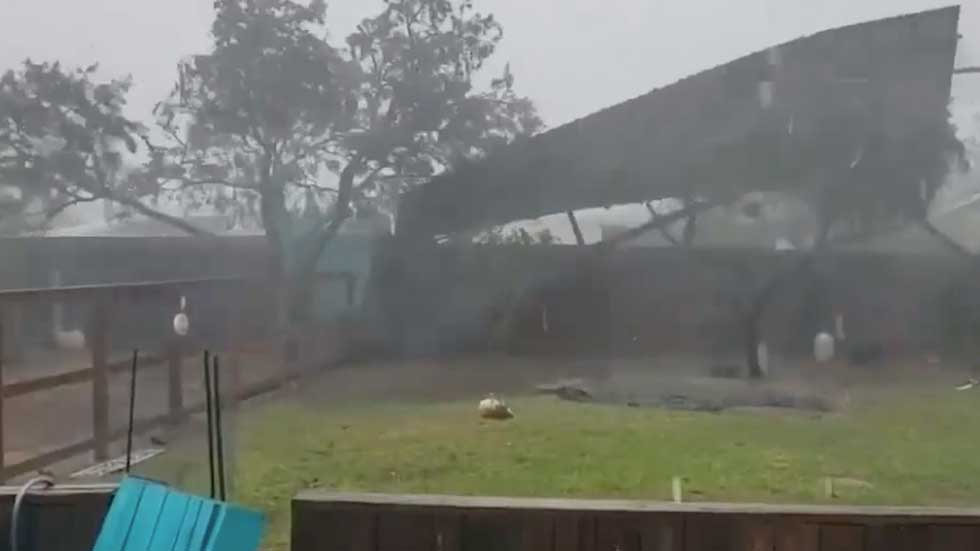 Hanna's Winds Send Backyard Fence Flying in Texas