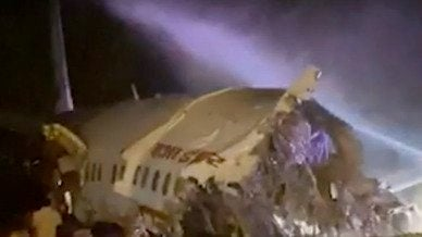 Air India Express Plane Skids off Rain-Soaked Runway, Killing at Least 14